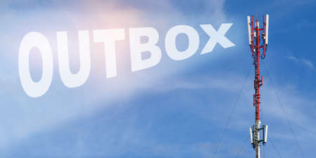 Communication and connection concept. Against the background of a blue sky with clouds it is written - OUTBOX