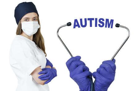 Health care and medicine concept. The doctor is holding a stethoscope, in the middle there is a text - AUTISM 免版税图像