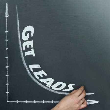 Business and finance concept. A graph is drawn on the board and it is written - GET LEADS
