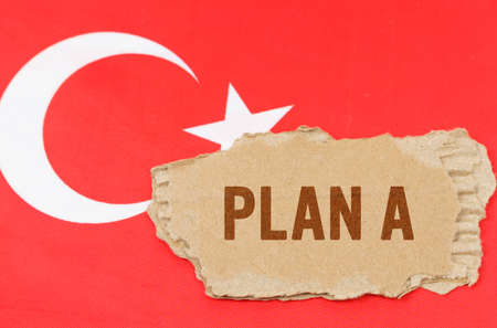 Business and finance concept. Against the background of the flag of Turkey lies cardboard with the inscription - PLAN A