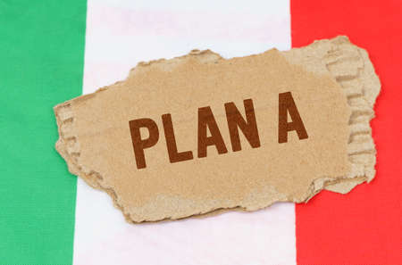 Business and finance concept. Against the background of the flag of Italy lies cardboard with the inscription - PLAN A