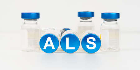 Medicine and health concept. On the blue roofs of the injections it says - ALS Stock fotó