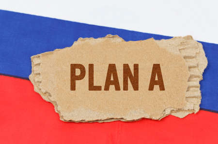 Business and finance concept. Against the background of the Russian flag lies cardboard with the inscription - PLAN A