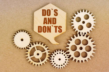 Business and economics concept. On a paper background, gears and a thought plate with the inscription - Do S And Don Ts