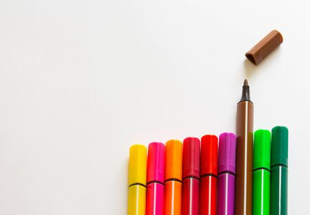 Multi-colored markers on a white background. School Suppliescopyspace for text. Imagens