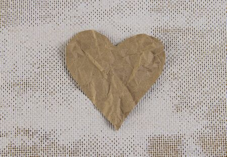 Torn paper heart in the center, isolated. On a white background. 版權商用圖片