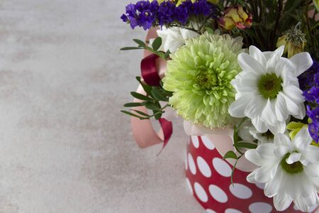 Floral bunch in round box. Bouquet in red color of beautiful Mixed flowers. Excellent garden flowers in the arrangement , the work of a professional florist. Gift box.
