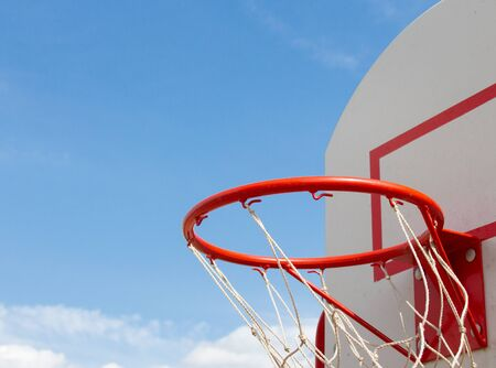 basketball net closeup outdoors. Against the blue sky. Copy for text