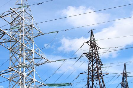 Electric wires on steel poles. High voltage power line. The concept of industrial ecology