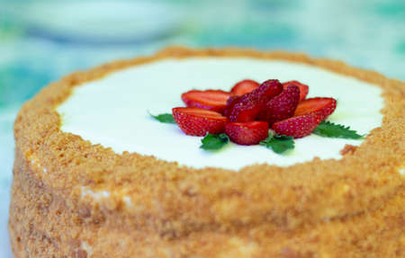 Homemade cake decorated with strawberries and strawberries and mint leaves. close-up. home baking concept.