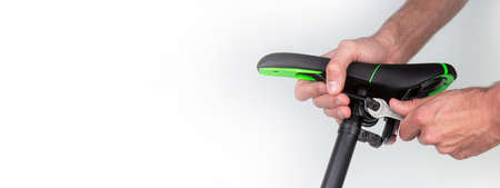 Adjusting and repairing a bicycle saddle. Isolated horizontal photo. copyspace for text Stock Photo