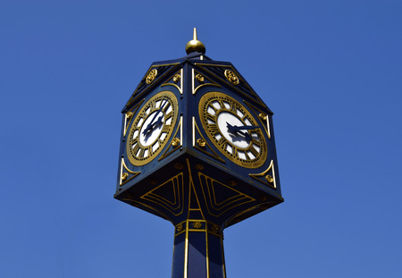 Big clock in Walsall on sunny day .  Big clock on the blue sky in United Kingdom