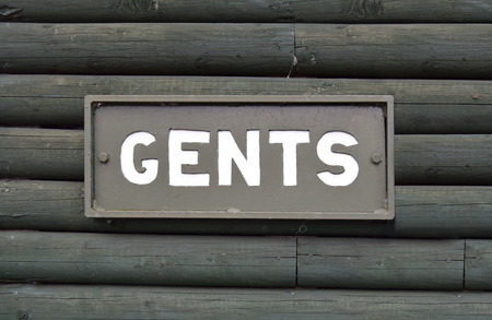 gent's: Gents toilet sign on the wood wall Stock Photo