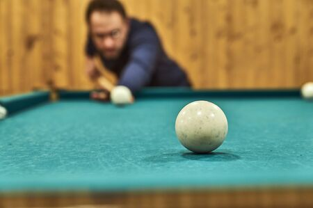 billiards halls: Middle-aged man playing billiards in the club.