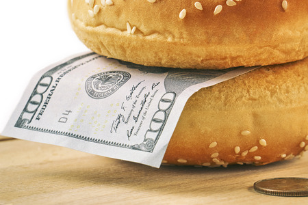 Hamburger with one hundred dollar bill