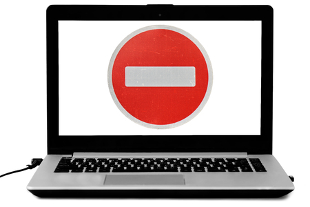 Laptop with a do not enter road sign on the screen isolated on white. Denied access concept. Banque d'images