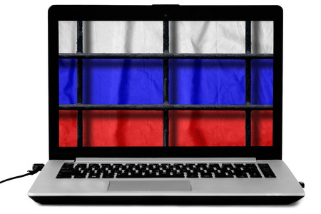 Laptop with black metal bars of a grate and a russian flag on the screen isolated on white background Stock Photo