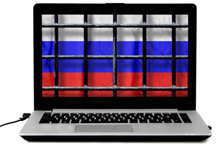 Russian flag behind black metal bars of a grate on the computer screen isolated on white background. Symbol of the law about disconnecting the Russian Internet from the world wide web