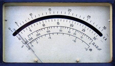 Vintage analog ammeter and voltmeter scale with an arrow