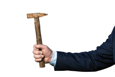 Businessmans hand in suit holding an old rusty hammer isolated on white
