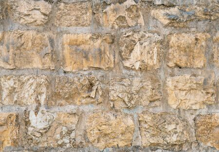 Medieval ancient stone wall in old Jerusalem seamless texture background. Фото со стока