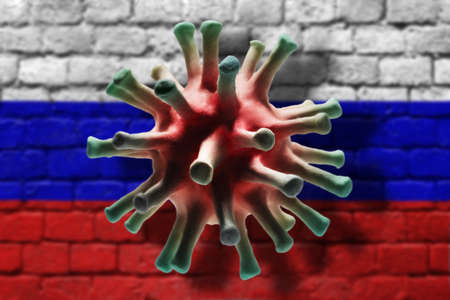 Coronavirus cell on the brick wall painted in russian flag colors background with shadows. A pandemic of coronavirus in Russia concept