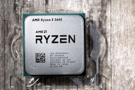 Moscow, Russia - May 10, 2020. Modern AMD Ryzen 5 3600 CPU main computer processor on the wooden boards