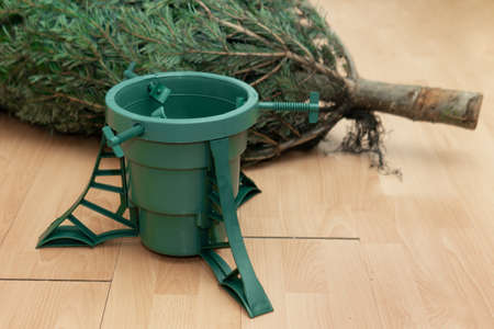 Just purchased Christmas tree lying on the floor next to a plastic stand