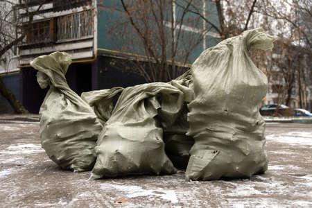 Bags of construction waste on the Moscow street in winter