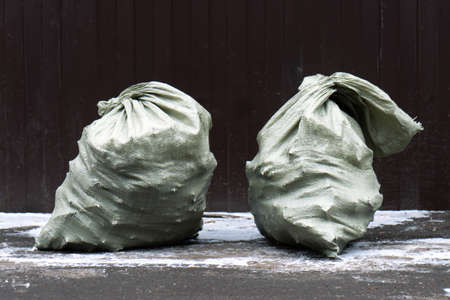 Two Bags of construction waste outdoors in winter Stock Photo