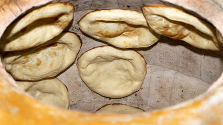 Armenian flatbread lavash is being baked in an oven