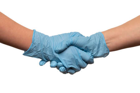 Handshake of gloved hands of doctors or people during covid-19 pandemic isolated on white Stock Photo