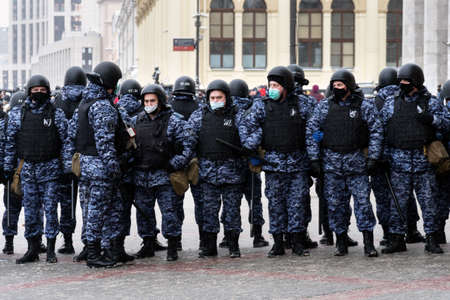 Moscow, RUSSIA - January 31, 2021: Police officers stand in a cordon on unauthorized political rally in support of the arrested opposition leader Alexei Navalny on Komsomolskaya Square in Moscow. Publikacyjne