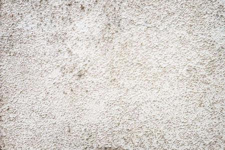 Gray uneven rough cement or concrete background Фото со стока