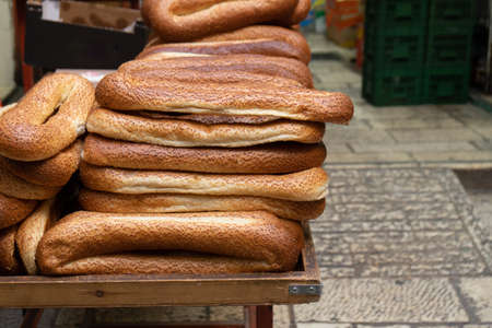 A lot of traditional arabian bread bagele on the street counter in old Jerusalem, Israel