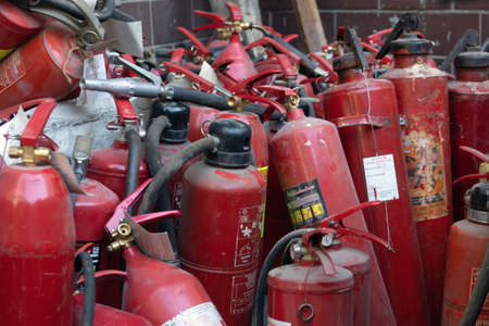 Moscow, Russia-June 4,2021. dump of old fire extinguishers