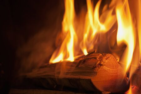 incendiary: Close-up shot of wood burning in flames