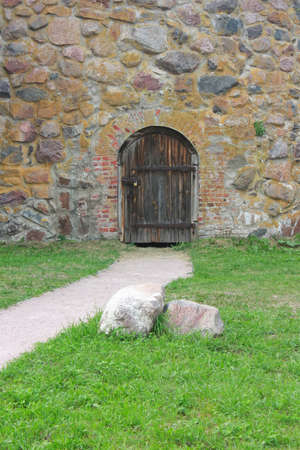 Old door in to a stone wall Stock Photo - 7985214
