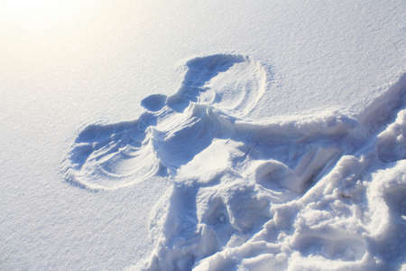 Big picture of the snow angel on January clean snow photo
