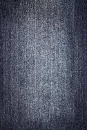Texture of blue worn denim with light middle and dark edges Stock Photo