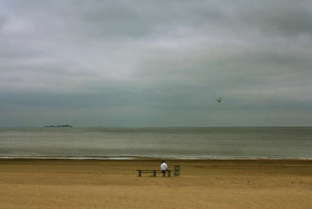 Lonely person on a background of the sea