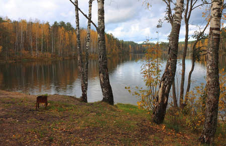 Cloudy autumn landscape with lake, Russia