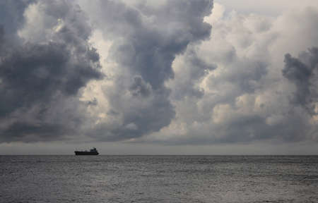 Sea landscape with the ship on a background of storm clouds, the Black sea