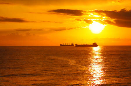 Gold sunset with the ships, Black sea