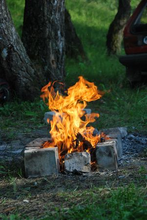 a fire at a picnic in the summer Stock Photo