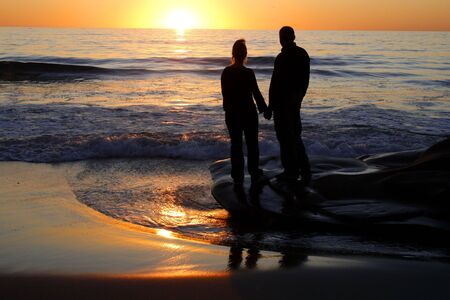 Romantic evening. Men and women waiting for sunset.