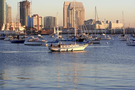 california, evening san diego skyline. boats on the water.
