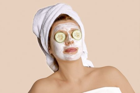 woman taking car of her face after spa.