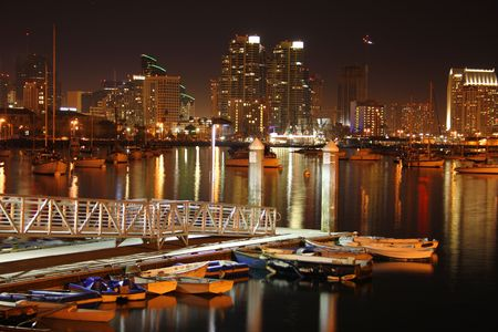night time san diegoskyline. boats waitin for morning.