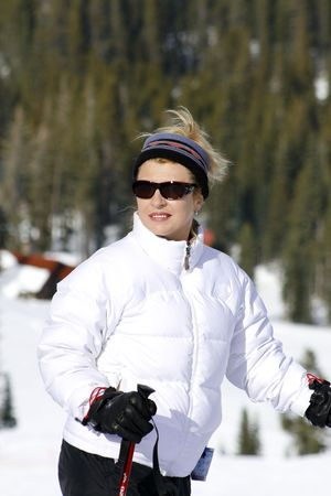Sunny day in Mountains, woman ready for ski. Stock Photo